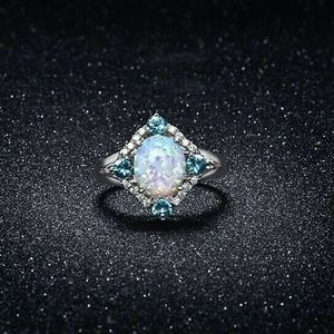 Jewelry - Aquamarine Opal Ring Set in 18K White Gold Size 8